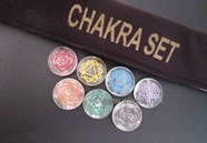 Picture of Crystal Quartz Engrave Chakra Colourful Disc set with velvet purse